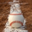 Baseball on the Chalk Line — Stock Photo #13441125
