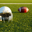 Stock Photo: Football Helmet and Ball on Field