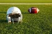 Football Helmet and Ball on the Field — Stock Photo