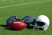 American Football and Helmet on the Field — Stock Photo