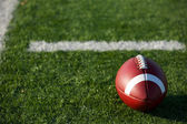 American Football near the hashmarks — Stock Photo