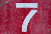 Number Seven on Painted Cement — Stock Photo