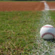 Stock Photo: Baseball on Chalk Line