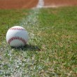 Baseball on the Chalk Line — Stock Photo #22066729