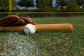 Baseball Bat and Glove on the Field — Stock Photo