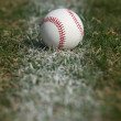 Baseball on the Chalk Line — Stock Photo #31860223