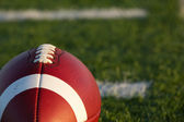 American Football Close Up with Field Beyond — Stock Photo