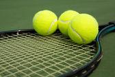 Tennis Balls on a Racket — Stock Photo