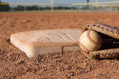 Baseball in a Glove near the base — Stock Photo