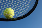 Tennis Ball on a Racket — Stock Photo