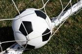 Soccer Ball in the Goal Net — Stock Photo