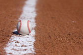 Baseball on the Infield Chalk Line — Stock Photo
