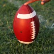 Stock Photo: AmericFootball held for kickoff