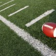 Stock Photo: Football amongst hashmarks or yard lines