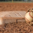 Stock Photo: Baseball and Glove near a Base