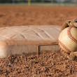 Baseball and Glove near a Base — Stock Photo