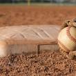 Baseball and Glove near a Base — Stock Photo #38318893