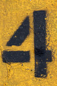 Number Four on Painted Asphalt — Stock Photo