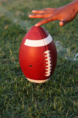 American Football held for kickoff — Stock Photo