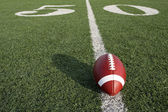 American Football with the Fifty Yard Line Beyond — Stock Photo