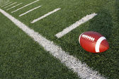 Football amongst the hashmarks or yard lines — Stock Photo