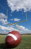 American Football with goal posts — Stock Photo