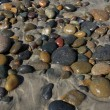 Smooth Beach Stones on the Sand — Stock Photo #38321363