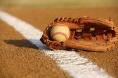 Used baseball in a glove — 图库照片