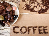 "Still life of chocolate, coffee beans, candy, the word ""coffee"" — Stockfoto"