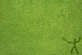Sport fence on green grass texture and background — Stock Photo