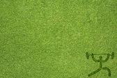 Sport gewicht op groen gras textuur en achtergrond — Stockfoto