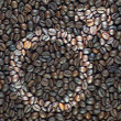 Gender msymbol icon on coffee texture and background — Stock Photo #13851242