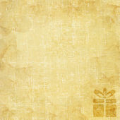 Christmas gift box icon on old paper background and pattern — Stock Photo