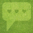 Comment icon on green grass background — Stock Photo #18557481