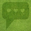 Comment icon on green grass background — Stock Photo #18557791