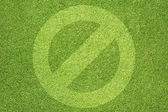 Label icon on green grass background — Stock Photo