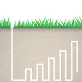Green grass with graph icon in soil — Stock Photo