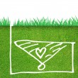 Stock Photo: Green grass with heart icon