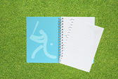 Book with Sport baseball icon on grass background — Stock Photo