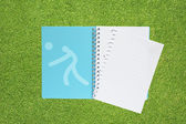 Book with Sport volley ball icon on grass background — Stock Photo