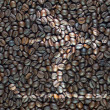 Label icon on coffee background and textured — Stockfoto
