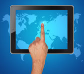 Hand pushing map of tablet on a touch screen — Stock Photo