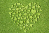 Heart icon on green grass background — Stock Photo