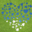 Heart icon with grass and sky — Stock Photo #24088787