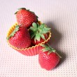 Stock Photo: Strawberries in muffin cup, baking ingredients for cupcake