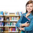 Foto de Stock  : Student at campus library