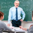 Teacher with students in classroom — Stock Photo #12622194