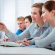 Students attending training course in a computer classroom — Stock Photo