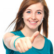 Teenager girl shows a thumbs up — Stock Photo