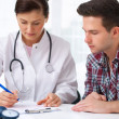 Doctor with male patient — Stock Photo #12822944